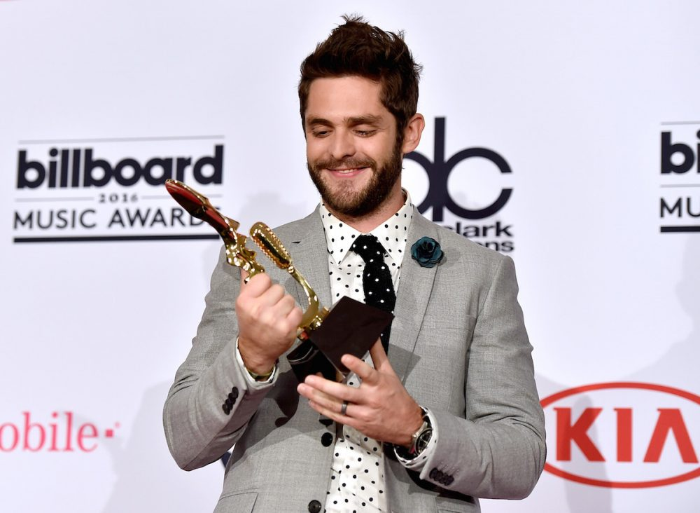 LAS VEGAS, NV - MAY 22: Recording artist Thomas Rhett, winner of the Top Country Song award for 'Die a Happy Man,' poses in the press room during the 2016 Billboard Music Awards at T-Mobile Arena on May 22, 2016 in Las Vegas, Nevada. (Photo by David Becker/Getty Images)